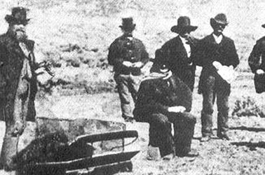 John D. Lee awaiting his execution by firing squad. Mountain Meadows, Utah, 1877.